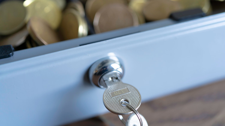 A lockbox of notes and coins